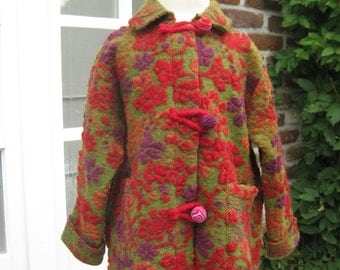 very nice Kidscoat from organic wool in very nice colors as green, pink and red