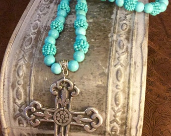 Long turquoise necklace with cross