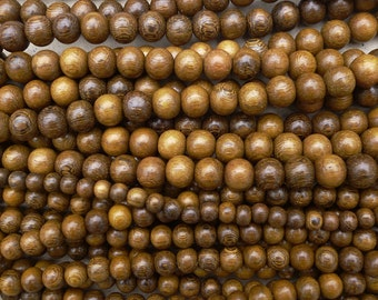 Natural Robles Wood Round Beads Various Sizes 16'' Strand