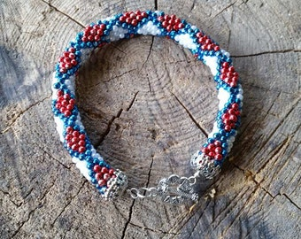 Bracelet from red, white and blue crocheted beads.