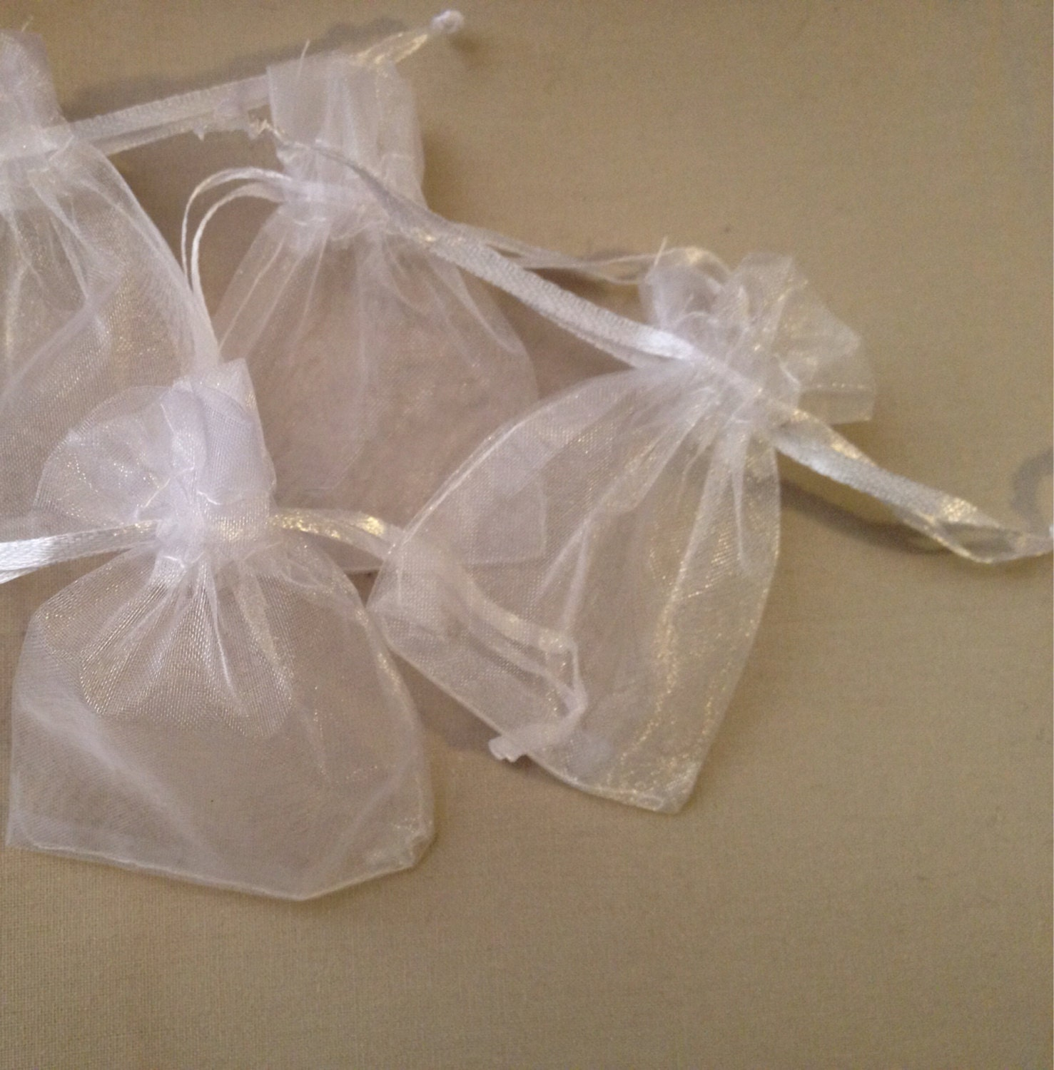 white organza drawstring bags wedding or event by typewright