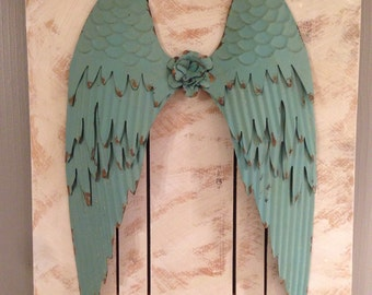 Large Turquoise Angel Wings made of tin. Attached to rough sawn White Washed cedar wood. Vintage/antique/pallet/natural/handmade/decor/walla