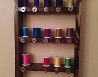 Thread and bobbin shelf