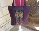 Beautiful top grain leather and hand beaded tote bag. Unique and one of a kind. Statement tote! Hand beaded detail is a real eye catcher.
