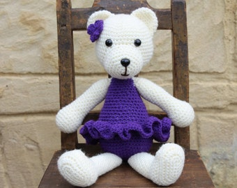 Handmade, crocheted toy teddy bear for children and babies in purple and cream