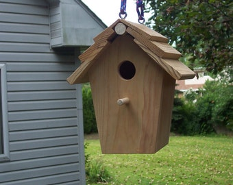 Shaker roof style vented nuthatches birdhouse.