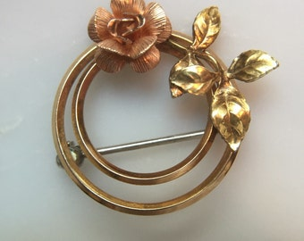 Vintage Krementz gold tone circle and rose brooch (two available)