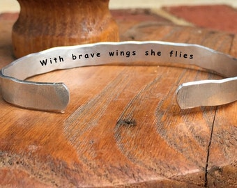 "With brave wings she flies - Inside Secret Message Hand Stamped Cuff Stacking Bracelet Personalized 1/4"" Adjustable Hand"