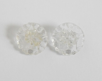 Set of 2 colorless vintage glass buttons with star motif
