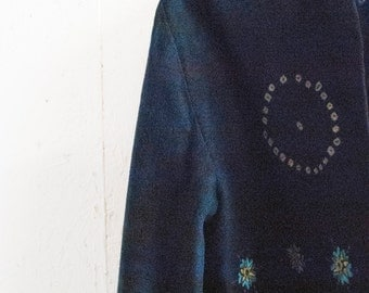 Navy cropped jacket with embroidered, mirrored detail. Made in Sweden.