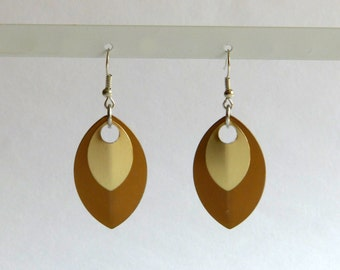 Earrings from scales, bronze gold