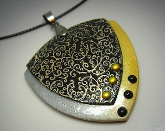 Swirly triangle polymer clay pendant necklace in black, gold and silver with rivets