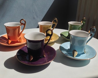 An absolutely stunning 6 mixed colour coffee set by Genevieve Lethu