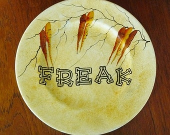 Freak hand painted vintage dinner sized plate with leafy motif and hanger recycled humor freaky display