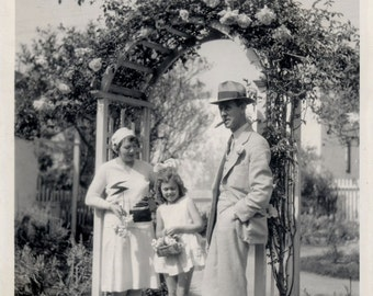 vintage photo Family under a Rose Arbor Holding Roses