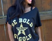 Be Bold Go Gold- Childhood Cancer Awareness Month Wide Shouldered Tee.  Collaboration with The Ronan Thompson Foundation.