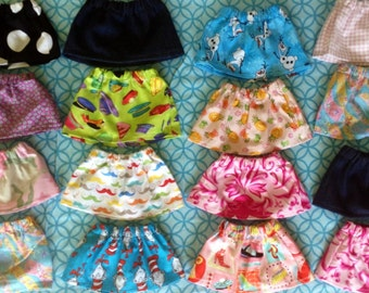 New Skirts to fit 18 inch doll...will fit American Girl Dolls ..Need a matching child sized one?