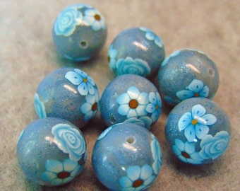 round foiled polymer clay beads with blue flowers