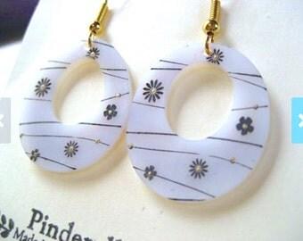 Floral oval hoop earrings