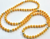 yellow beaded necklace, mid length yellow necklace. minimalist necklace