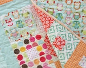 Baby and Toddler Girl Quilt in Aqua Pink Green and Orange features Owls Flowers Polka Dots and Stripes