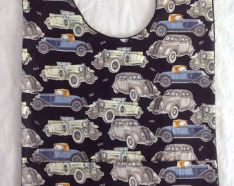Adult bib with crumb catcher pocket vintage vehicles fabric