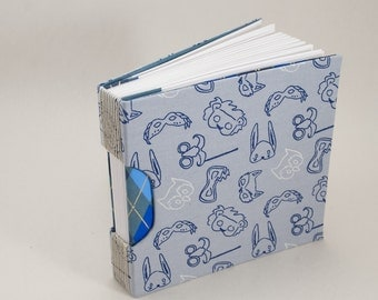 Blank Journal Notebook Guestbook or Sketchbook with a Party Animal Mask Fabric Cover
