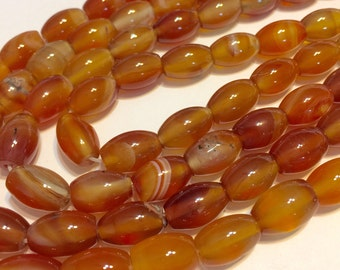 "Carnelian barrel shaped beads full 14"" stand."