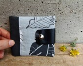 Black and grey wallet with leaves. Unisex bifold wallet in cotton fabric with recycled leather flap