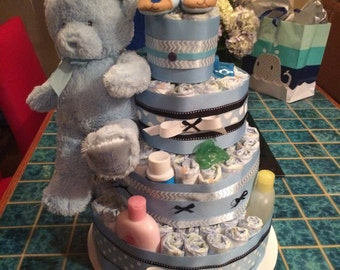 Baby blue four-tiered diaper cake for baby boy shower - with bear and accessories