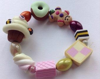 Polymer clay mixed bead novelty bracelet inc gingerbread, flump, cupcake etc