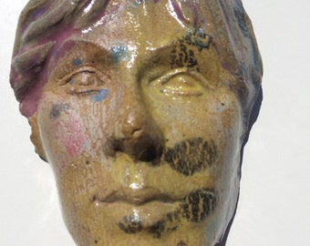 Wall mask face sculpture head, ceramic art portrait of Abba singer, rock star woman