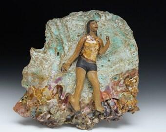Ceramic art wall tile relief figure sculpture glaze painting wabi sabi woman in the sky, dancer in shorts, tank top