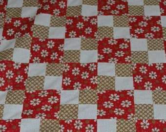 Red Tan and White Flower Baby Quilt