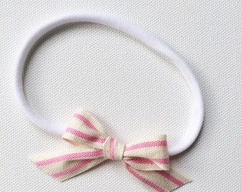 Pink candy striped bow headband
