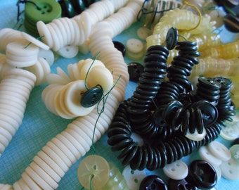 Grab Bag of Buttons. 7 oz of mostly 1/2 inch diameter. some 3/8 inch. White, brown, green Vintage supply