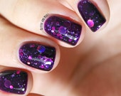 "Nail polish - ""Cosmic Forces"" holographic dot glitter in a dark purple base"
