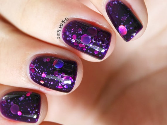 """Nail polish - """"Cosmic Forces"""" holographic dot glitter in a dark purple base"""