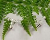Silver Dinosaur cufflinks: A pair of Dinosaur shaped sterling silver cufflinks.