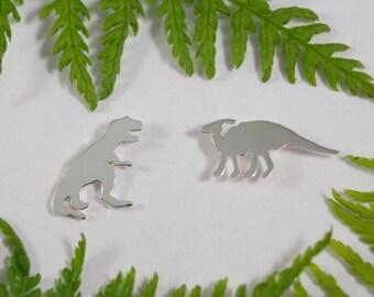 Silver Dinosaur earrings: A pair of Dinosaur shaped sterling silver earrings.