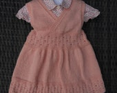 Pretty vintage pinafore dress for a baby girl/toddler age 1-2 yrs, hand knitted in pale pink yarn.