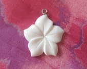 Beautiful hand carved flower. A loop on the top to accomodate your jewelry making needs