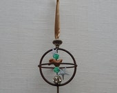 vintage gyroscope ornament. suspended in space.  one of a kind original hanging art. boho chic.