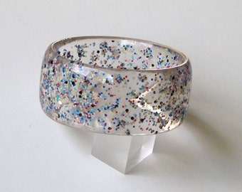 Clear resin bangle bracelet with embedded red white blue particles