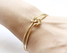 Double Knot Bangle / Love Knot bracelet, gold and silver