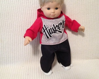 15 inch doll (modeled by Bitty Baby) Nebraska hoodie and black pants