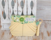 Eco-friendly retro and vintage style wristlet or clutch with strap zipper closure with folds shabby chic lemon yellow ecycled cosmetic case