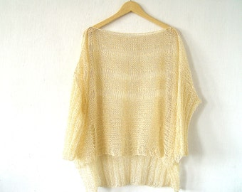 Relaxed Cream Sweater.