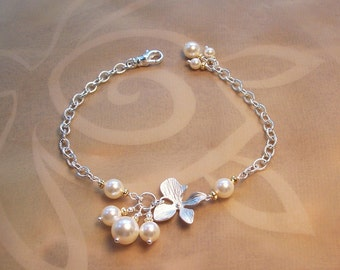 A Pearl and Orchid Bracelet