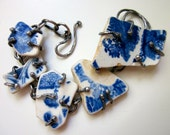 Don't Hold On To What's Not Known - primitive found object blue and white Scottish beach pottery & sterling silver metalwork prong bracelet